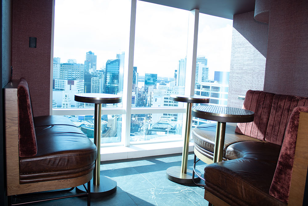A more casual style area accommodating up to 12 guests with a combination of seated and standing space.  This area sits below the upper mezzanine and has spectacular views down Queen Street. Minimum spend requirement starts at $1000.
